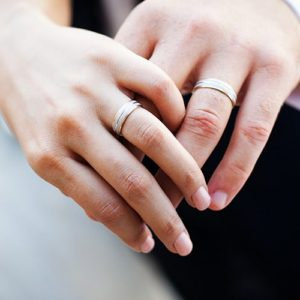 wedding-rings-on-hands-blog-wedding-ring-guide